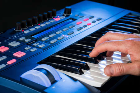 person playing a keyboard photo
