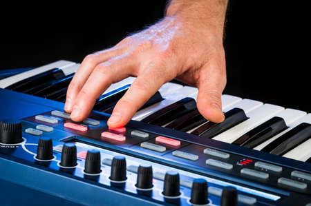 a person playing a keyboard photo