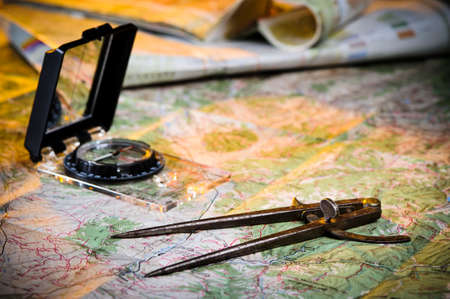 orienteering: using a compass and map to plan a journey Stock Photo