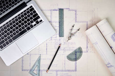 architect tools: architects blue prints and a laptop computer Stock Photo