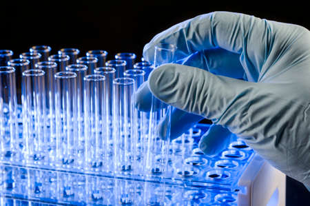 a researcher holding a test tube Stock Photo