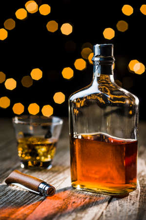 retro bottle: a bottle of whiskey and a vintage knife