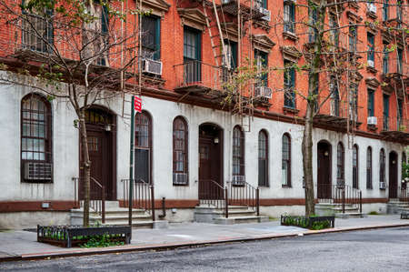 a row of brownstone townhomes