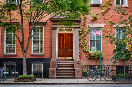 The front of an ornate brownstone building. Stock Photo