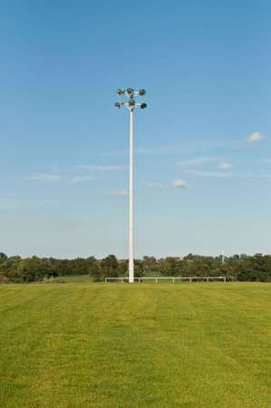 A light standard holds high intensity lights to allow night use of a sports field.