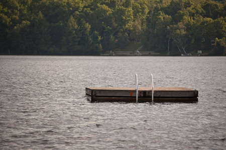 A swimming platform anchored in a lake.