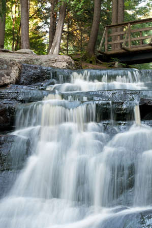 A small waterfall flows down the rocks in northern Ontario. photo