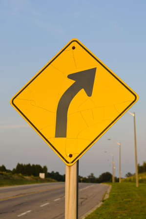 curve: A traffic sign warning of a right curve ahead in the road Stock Photo