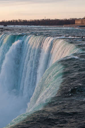 horseshoe falls: A view of the brink of Niagara Falls (Horseshoe Falls) taken at dawn from the Canadian side.