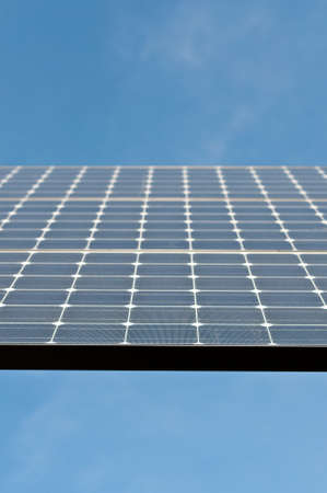 Closeup of a Photovoltaic Solar Panel with Blue Sky Stock Photo