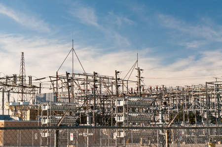 high voltage: An electrical substation steps down high voltage electicity for domestic and commercial  distribution.