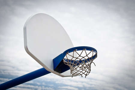 backboard: A basketball hoop and backboard in an outdoor playground. Stock Photo