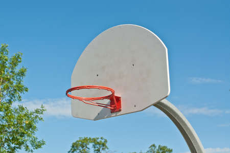 An outdoor basketball hoop in a local park. Stock Photo