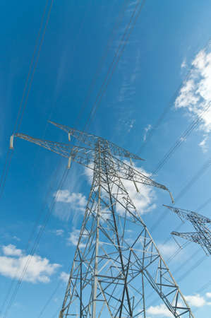 A pair of electrical transmission towers carrying high voltage lines. Stock Photo - 8825468
