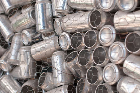 A container of aluminum drink cans collected for recycling