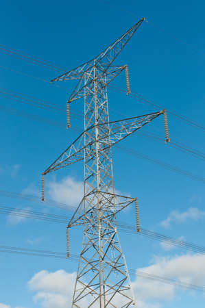 An electrical transmission tower carrying high voltage lines.