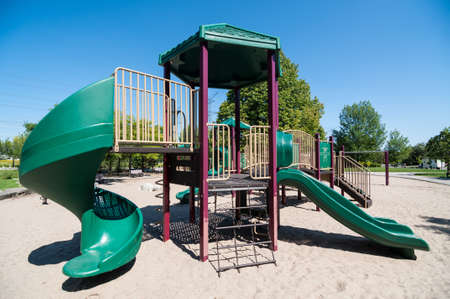 playground equipment: Playground equipment in a sandy play area in a public park.