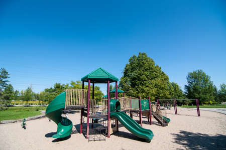playground equipment: Playground equipment in a sandy play area in a public park