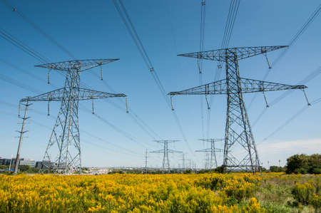 An Electrical pylon or tower  carries high voltage lines