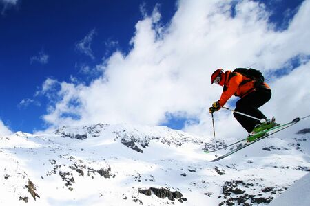 freeride: Free ride skier dropping from big cliff Stock Photo