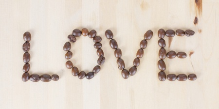 Picture of a the word LOVE made of coffee beans photo