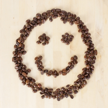 free stock photos: Picture of a smiley face made of coffee beans