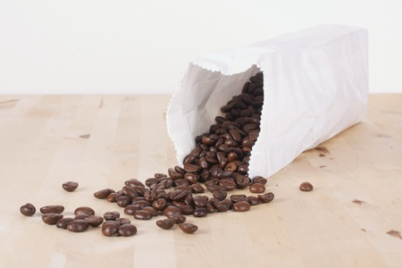 Picture of coffee beans rolling out of a bag photo