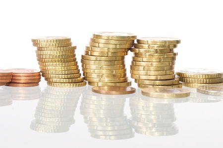 Picture of coins stacked, white isolated background Фото со стока