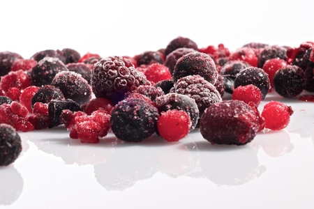 Picture of various frozen berries on a white background photo