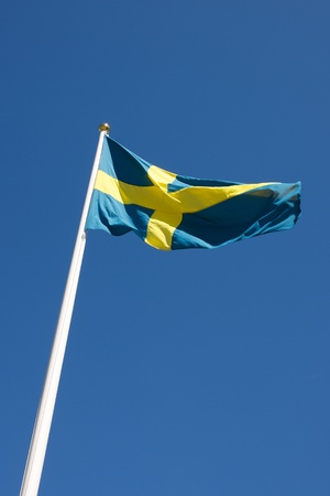 Picture of Swedish flag waving in the wind, on a blue sky photo