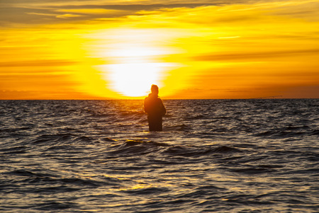 botas altas: Angler in autumn sunset at coastline, stock picture by Brian Holm Nielsen