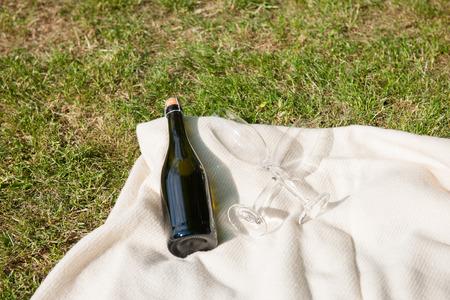white blanket: Champagne bottle and glasses on white blanket
