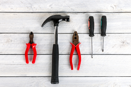 Stock picture of tools and screws on a wooden background Archivio Fotografico