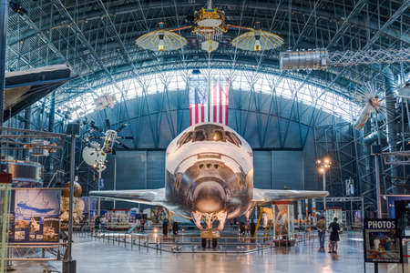 steven: Chantilly, VA - March 23, 2016: Space Shuttle Discovery OV-103 on display in the James S. McDonnell Space Hangar in the Smithsonian National Air and Space Museum (NASM)s annex, Steven F. Udvar-Hazy Center