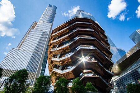 New York, NY / United States - June 22, 2019: A landscape shot the Vessel at the Hudson Yards district in Manhattan