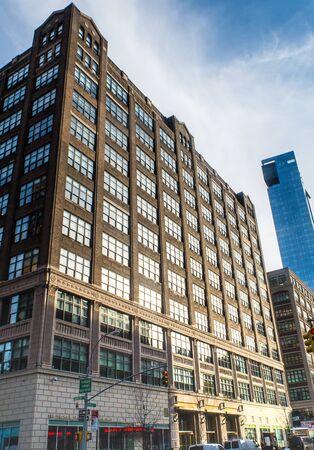 New York, NY / Unites States - Jan. 25, 2016: A vertical image of 160 Varick Street in Hudson Square section of SoHo. Sajtókép