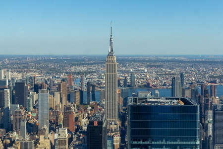 New York, NY / United States - Oct. 14, 2020: a panoramic landscape view of the Manhattan skyline, featuring the Empire State Building and the East River the distance. Editorial