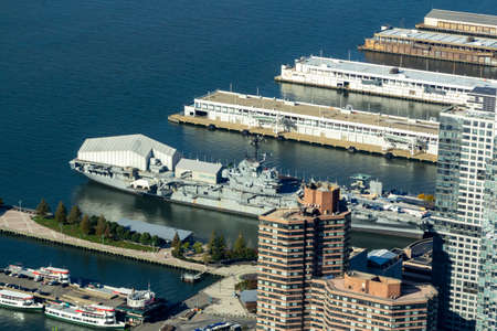 New York, NY / United States - Oct. 14, 2020: a an aerial closeup of Intrepid Sea, Air & Space Museum at Pier 86 at 46th Street, along the Hudson River, in the Hell's Kitchen neighborhood in Manhattan