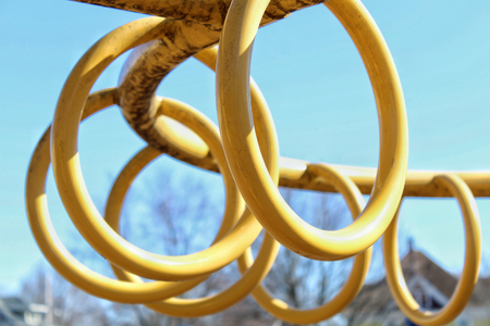 Monkey Bar Rings in a loop At The Park for climbing On A Sunny Day Imagens
