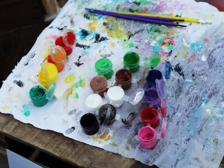 Tools of a festival face painter with brushes and paints on a table Stock Photo