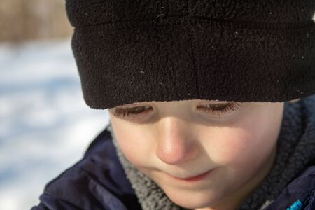 Young Winter Boy Up Close in Hat