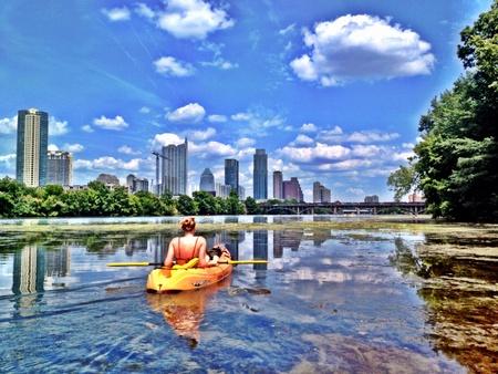 Girl with yellow Kayak