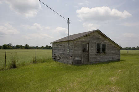 A cabin behind an old abandoned gas station.