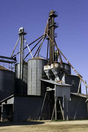 Old galvanized metal grain bins still in use in Latta, South Carolina.  Stock Photo