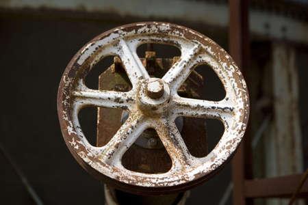an old rusted steel valve wheel on a grain bin in South Carolina.