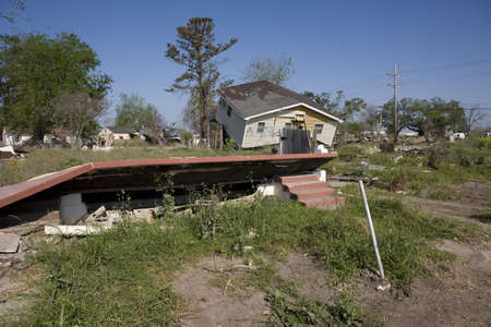 Heavily damaged homes in the Ninth Ward of New Orleans. One block behind these homes is the industrial canal that collapsed during the storm surge of hurricane Katrina. The flood waters carried the home on this lot several blocks away (out of frame).