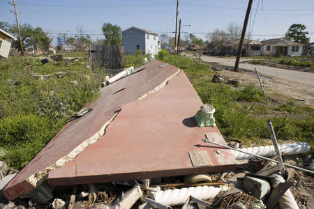 Heavily damaged homes in the Ninth Ward of New Orleans. One block behind these homes is the industrial canal that collapsed during the storm surge of hurricane Katrina. This concrete porch was carried several feet by the flood waters off the broken canal.