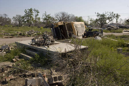 fled: All that remains of the home on this site is some rubble and the concrete porch.  Scenes like this are over powering in the Ninth Ward of New Orleans. A school bus and ruined pickup truck lay on their sides one block from where the industrial canal collap Stock Photo