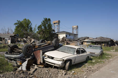 The flooding caused by hurricane Katrina left cars piled up in the Ninth Ward of New Orleans. Two blocks away is the section of the industrial canal which gave way  during the storm surge.