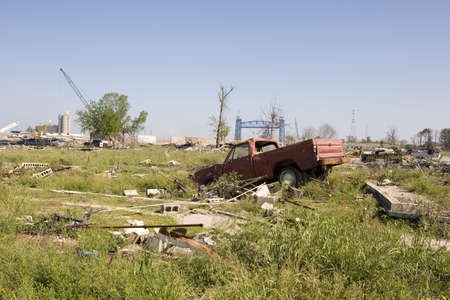 fled: A vast emty lot where a neighborhood once stood. The flood waters of hurricane Katrina breached the levy wall seen in the background decimating the neighborhood, New Orleans Ninth Ward.